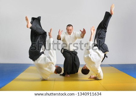 Martial art of Aikido . Demonstration of Aikido techniques . Royalty-Free Stock Photo #1340911634