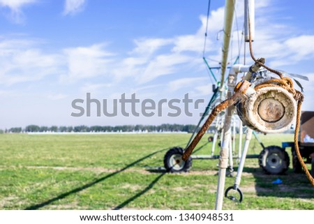 rain drop irrigation system to save water and growing green fields in Saudi Arabia  #1340948531