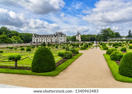 CHENONCEAU, FRANCE - JULY 2, 2016: A beautiful gardens surrounds the Chateau de Chenonceau. The Chateau de Chenonceau is located in Chenonceau near Amboise in the Loire Valley. #1340963483