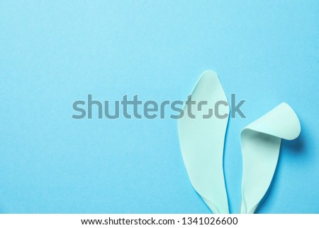 Funny Easter bunny ears on color background, top view with space for text #1341026600