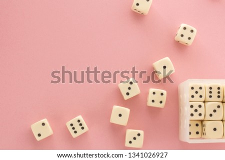 White gaming dices on pink background. victory chance and lucky. Flat lay style, place for text. Top view and Close-up cube. Concept business, gamble and game. Spectacular background pastel. #1341026927
