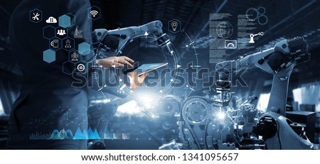 Manager Technical Industrial Engineer working and control robotics with monitoring system software and icon industry network connection on tablet. AI, Artificial Intelligence, Automation robot arm #1341095657