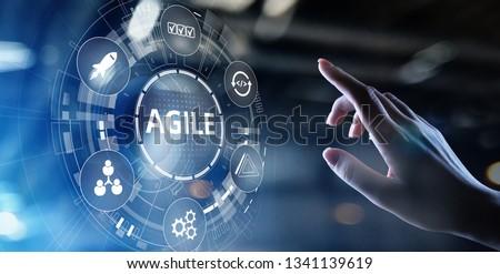 Agile development methodology concept on virtual screen. Technology concept. #1341139619