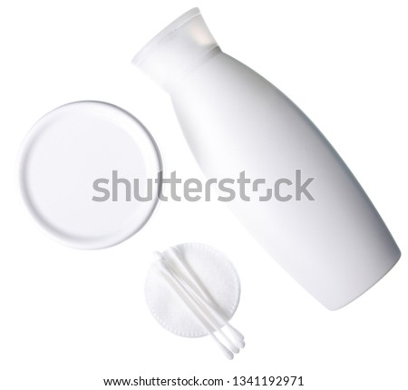 Bottle cosmetic cream lotion, cotton pads, ear sticks on white background isolation, top view #1341192971