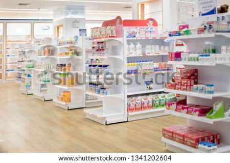 At the chemist, Medicines arranged in shelves, Pharmacy drugstore retail Interior blur abstract backbround with medicine healthcare product on cabinet with neon light. #1341202604