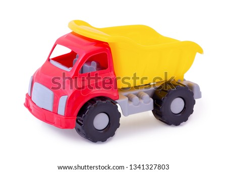 Vintage dump truck isolated on white background wih shadow reflection. Plastic child toy on white backdrop. Dump tipper truck lorry construction vehicle. Plastic children's toy. Kid's plaything. #1341327803