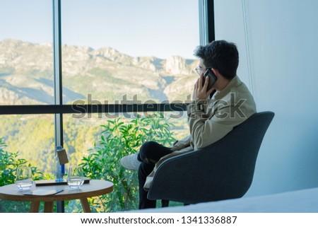 youn man using mobile phone #1341336887