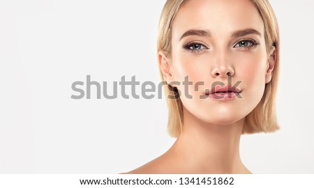 Beautiful Young Woman with Clean Fresh Skin . Facial  treatment   . Cosmetology , beauty  and spa . Blonde girl with short hair and a clean face. #1341451862