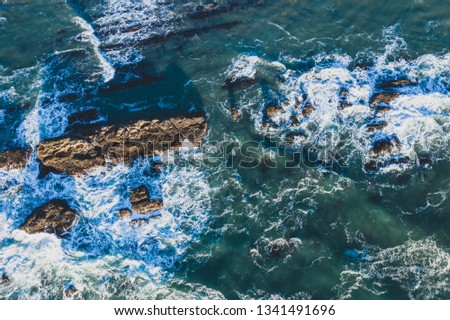 Dramatic and powerful ocean waves photographed top down with a drone #1341491696
