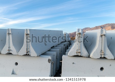 A stack of concrete barriers #1341515978
