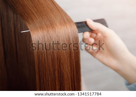 Saturated healthy shiny hair after dyeing. Concept of recovery structure. Royalty-Free Stock Photo #1341517784