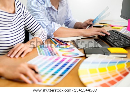 designer graphic creative creativity working together coloring using graphics tablet and a stylus at desk with colleague  #1341544589