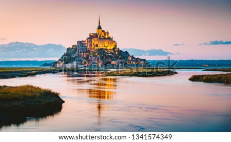 Classic view of famous Le Mont Saint-Michel tidal island in beautiful evening twilight at dusk, Normandy, northern France #1341574349