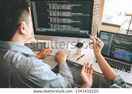 Team of Professional Developer programmer cooperation meeting and brainstorming and programming in website working a software and coding technology, writing codes and database. #1341616220