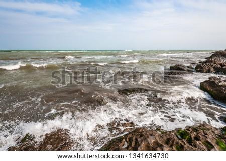 Splash of waves on a rocky seashore landscape #1341634730