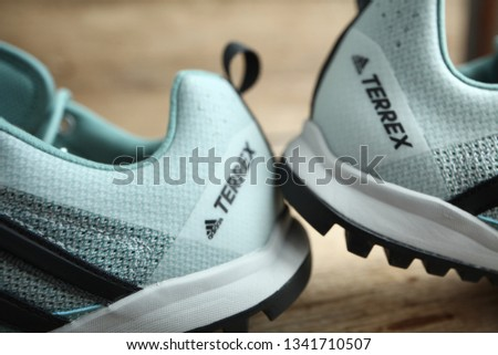 Belarus,Minsk,march 17. Fashionable women's sneakers Adidas terrex for active sports in the air. #1341710507
