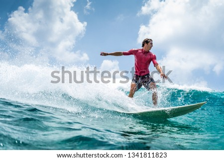 Surfer rides the wave at sunny day #1341811823