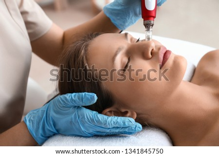 Young woman undergoing procedure of bb glow treatment in beauty salon #1341845750
