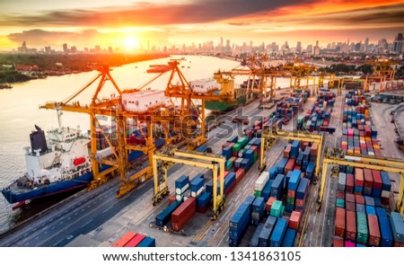 Logistics and transportation of Container Cargo ship and Cargo plane with working crane bridge in shipyard at sunrise, logistic import export and transport industry background #1341863105