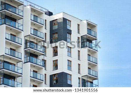 Multistory new modern apartment building. Stylish living block of flats. #1341901556