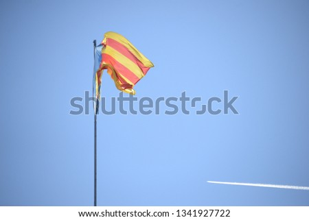 the valencian flag in the wind at spanish sky, spain #1341927722