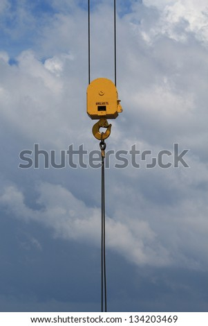 Heavy Duty Crane Hook with 45 Tons Working Load on a Blue Sky #134203469