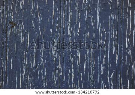 Texture of old wooden door painted in blue #134210792