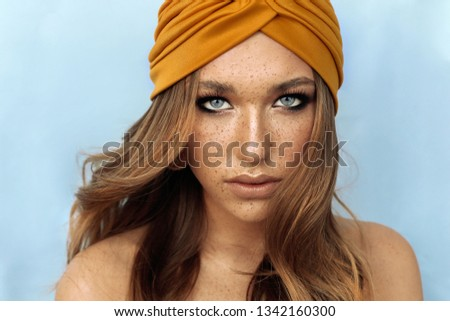 fashion studio portrait of beautiful young woman with brown hair and freckles face #1342160300