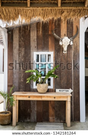 Close up of exotic  wooden reception desk sign in a tropical motel. Tourism and hospitality concept #1342181264