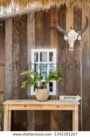 Close up of exotic  wooden reception desk sign in a tropical motel. Tourism and hospitality concept #1342181267