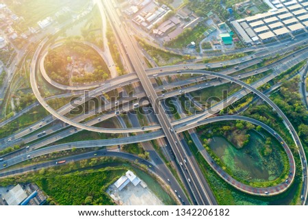 Bangkok Expressway top view, Top view over the highway,expressway and motorway at night, Aerial view interchange of a city, Shot from drone, Expressway is an important infrastructure in Thailand #1342206182