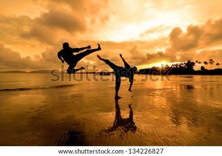 Fighting an enemy near the beach when the sun goes down Royalty-Free Stock Photo #134226827