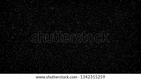 Flying dust particles on a black background #1342315259
