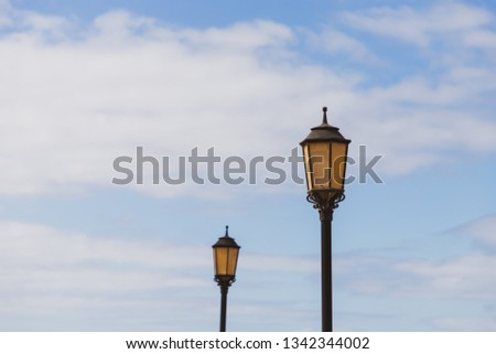 lanterns in front of blue sky #1342344002