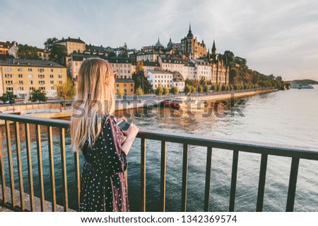Tourist woman sightseeing Stockholm city enjoying view traveling lifestyle summer vacations in Sweden   Royalty-Free Stock Photo #1342369574