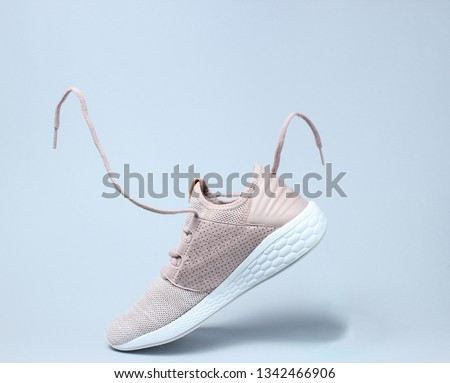 Running sports shoes with flying laces. #1342466906