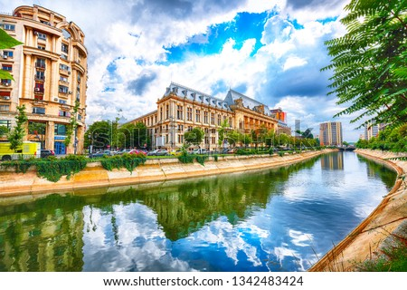 Antique building view in Old Town Bucharest city - capital of Romania and Dambrovita river. Bucharest, Romania, Europe.  #1342483424