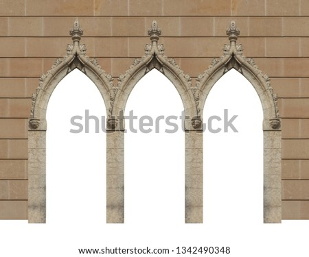 elements of architectural decorations of buildings, old doors with arches, gates with bars, on the streets in Catalonia, public places. #1342490348