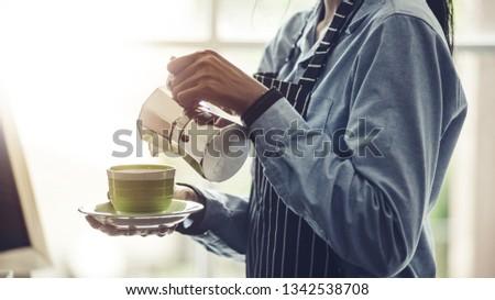 Barista making Espresso,  Americano, Cappuccino, Latte, Mocha, and preparing coffee drink. #1342538708