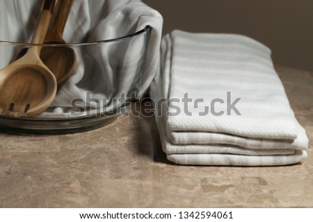 Clean Salad Bowl with Tossers and Fresh Towels #1342594061