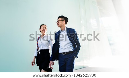 Asian business people in a discussion while walking #1342625930