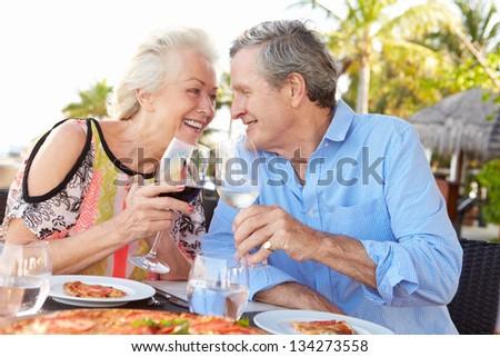Senior Couple Enjoying Meal In Outdoor Restaurant #134273558