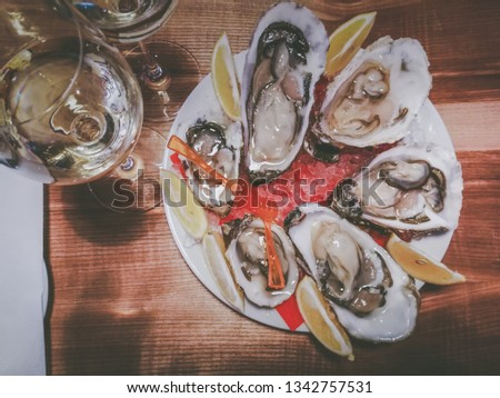 oysters with wine on the table #1342757531