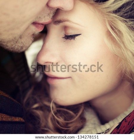 beautiful girl embraces the guy