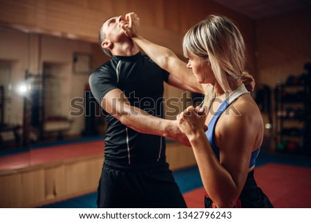 Female person on self-defense workout with trainer #1342796243