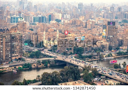 11/18/2018 Cairo, Egypt, panoramic view of the central and business part of the city from the observation deck at the highest tower of the African capital at sunset #1342871450