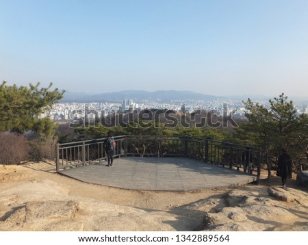 Seoul, South Korea, March 17, 2019, Two people are looking at Han river and eastern part of Seoul city on the viewing deck on Achasan mountain in east Seoul, Korea  #1342889564