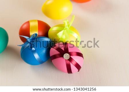 easter eggs on white wooden background #1343041256