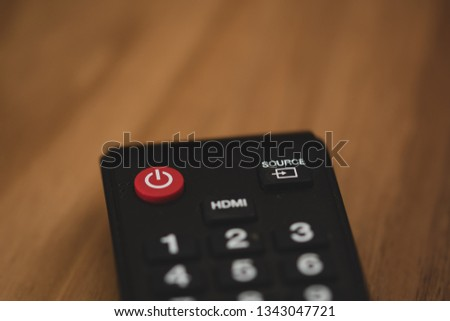 television remote controller on wood background #1343047721