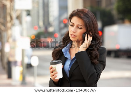 Businesswoman Outside Office On Mobile Phone #134306969